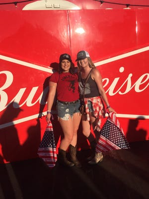 Courtney Davis, right, with her best friend Sierra Falkins. The two were at the Route 91 Harvest Festival in Las Vegas on Oct. 1, 2017.