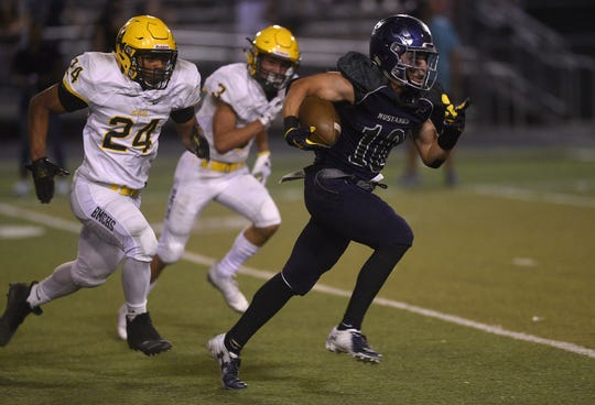 Damonte Ranch's Kyle McNamara (10) runs free while taking on Bishop Manogue during their football game in Reno on Sept. 28, 2018.