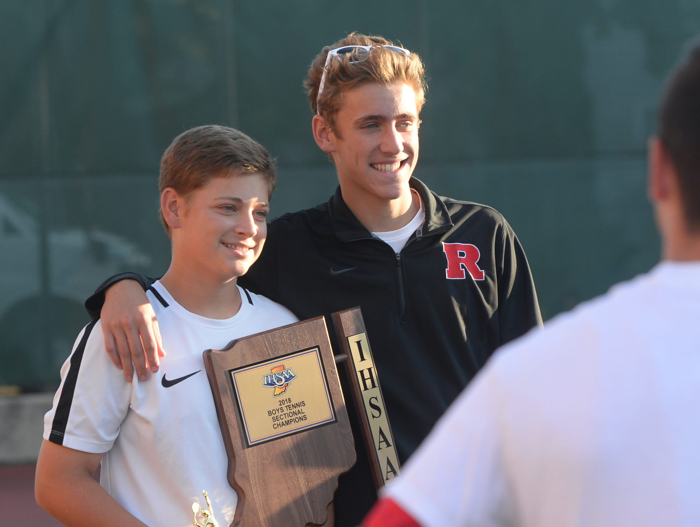 Kyle Hollingsworth, left, and brother Ryan, hold the sectional championship trophy after the Richmond High School boys tennis team defeated Centerville 5-0 to win a fifth consecutive sectional championship Friday, Sept. 28, 2018.