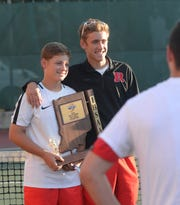 Kyle Hollingsworth, left, hold the sectional championship trophy after the Richmond High School boys tennis team defeated Centerville 5-0 to win a fifth consecutive sectional championship Friday, Sept. 28, 2018.