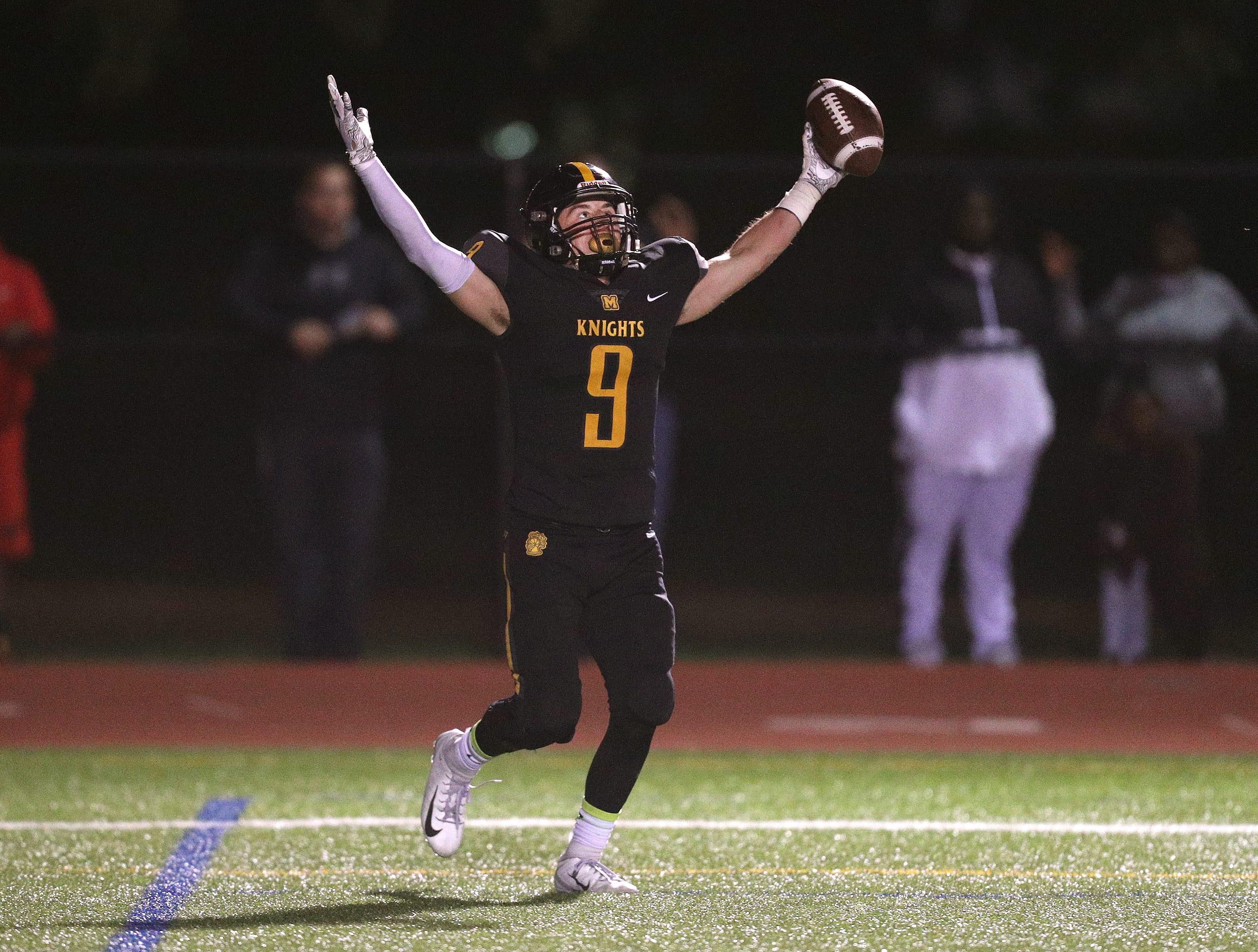 McQuaid's Ben Beauchamp celebrates a touchdown catch in a 38-34 win over Wilson.