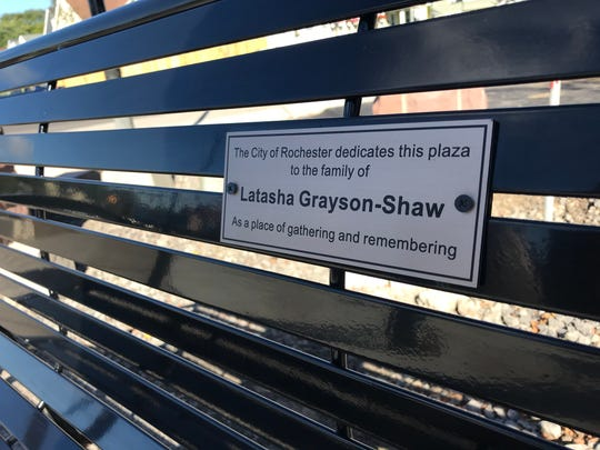 A plaque marking a bench at the newly dedicated Latasha Grayson-Shaw Memorial Park.