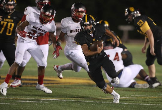 McQuaid running back Mark Passero finds open space against Wilson.