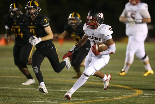 Wilson's Desi Floyd Jr. finds running room against McQuaid.