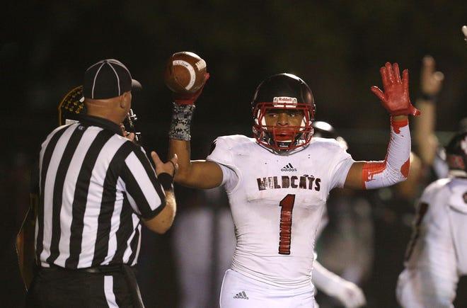 Wilson's Desi Floyd Jr. celebrates a touchdown.