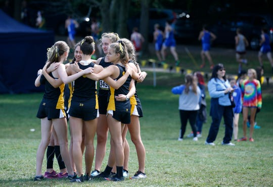 Honeoye Falls - Lima huddles before the Girls Varsity AA (Seeded Medium schools) Tony Canali Memorial race.