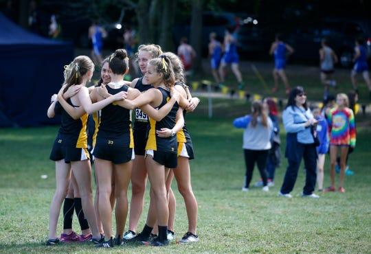 Honeoye Falls - Lima huddles before the Girls Varsity AA (Seeded Medium schools) Tony Canali Memorial race.
