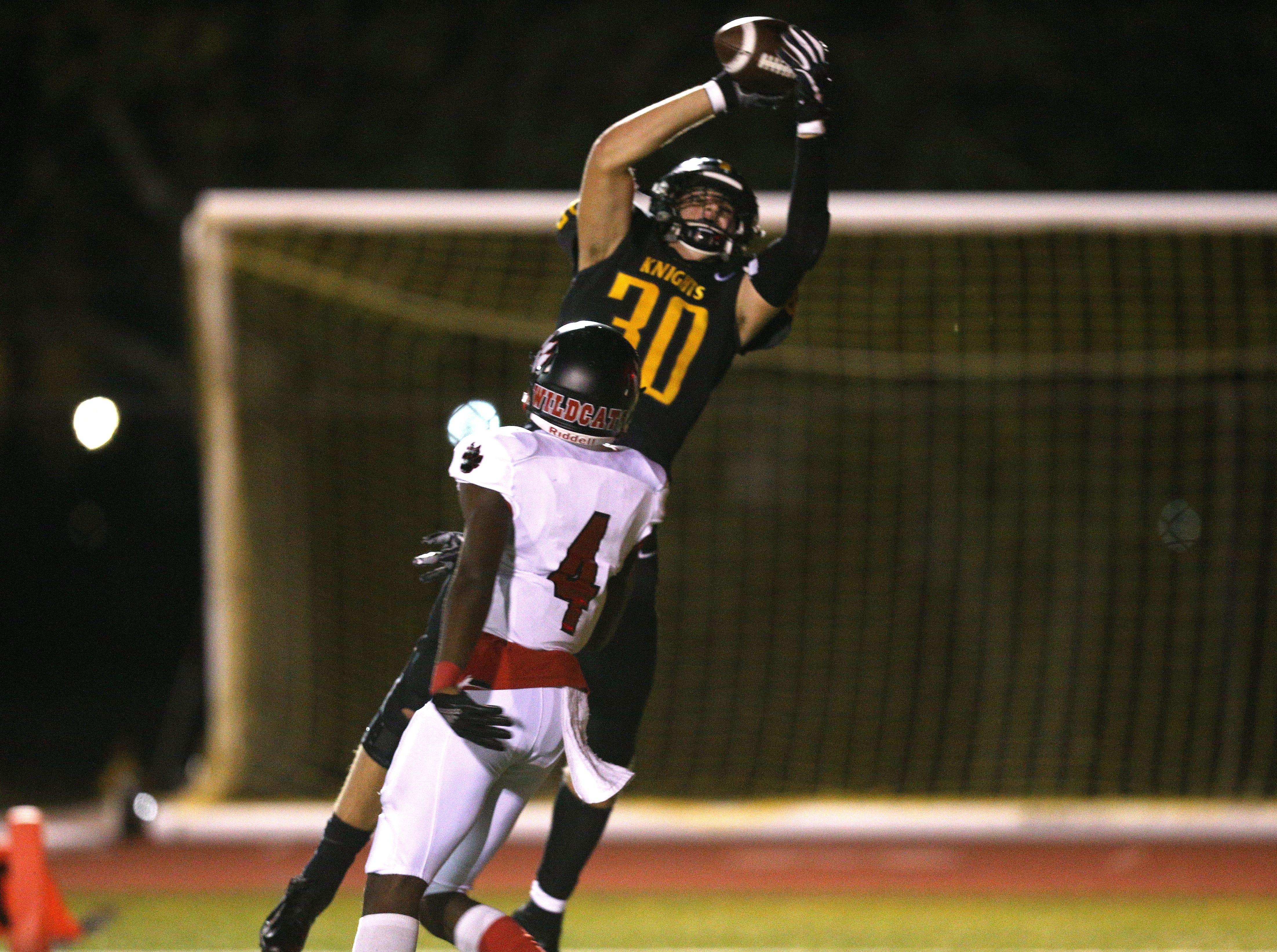 McQuaid's Connor Zamiara catch this touchdown pass against Wilson.
