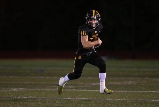 McQuaid quarterback Hunter Walsh tucks the ball and runs.