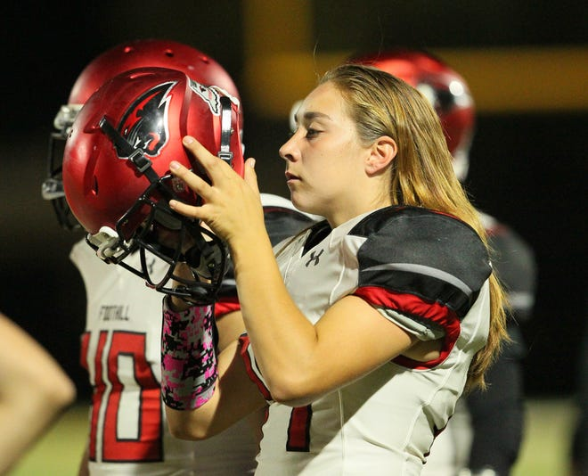 Foothill's Lilia Hoheisel (14) puts on her helmet during a game on Friday, Sept. 28.