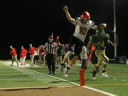 Foothill quarterback Jayden Gordon (10) jumps into the end zone to score a touchdown in the first quarter on Sept. 28, 2018, against Red Bluff.