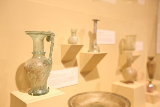 Single-handed Pitcher with Swirled Body: A Roman glass pitcher.