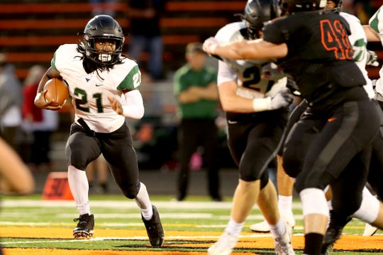 Tigard's Malcolm Stockdale (21) rushes in the first half of the Tigard vs. Sprague football game at Sprague High School in Salem on Friday, Sept. 28, 2018.