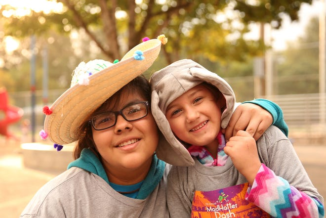 Marissa Morales, 15, left, and Nicole Torres, 5, both of Salem, at the Mad Hatter Dash, a 5K fun run benefitting the Salem Dream Center, at Wallace Marine Park in West Salem on Saturday, Sept. 29, 2018.