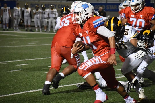 North Salinas running back Joe Zazueta (11) outruns a would-be tackler.