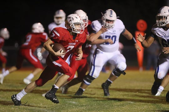 Christoval's David Fava (#7) tries to out run Winters' defense during Friday night's game in Christoval, Sept. 28, 2018.
