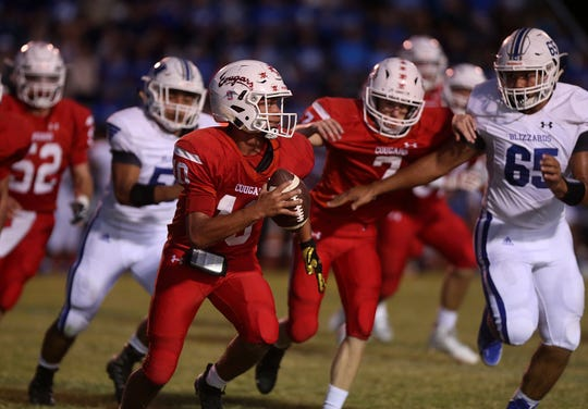 Winters' noseguard Cameron Perkins (65) zeroes in on Christoval quarterback Brayden Wilcox (10) during Friday night's game in Christoval, Sept. 28, 2018.