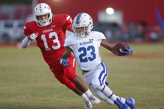 Winters' Sema'jae Jackson (23) tries to avoid being tackled by Christoval's Azul Salinas (13) during Friday night's game in Christoval, Sept. 28, 2018.