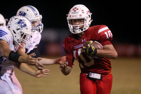 Christoval's Brayden Wilcox (10) is surrounded by Winters defenders during Friday night's game in Christoval, Sept. 28, 2018.