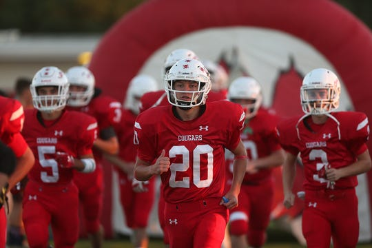 Christoval players run onto the field before their game against Winters on Sept. 28, 2018.
