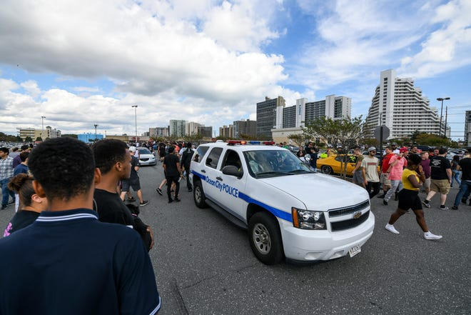 Police tell the crowd in the ACME parking lot over the loud speaker that they must leave the area on Saturday, Sept 29, 2018. Streets in Ocean City were full of crowds and cars for the unofficial H2Oi weekend, despite the fact that the car show has moved to Atlantic City.