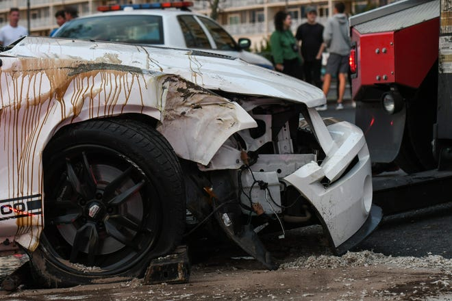 The wreckage of a mustang that flipped sits on the Coastal Highway in Ocean City on Friday, Sept 28, 2018. The crash caused a heavy traffic back-up, but no one was injured.