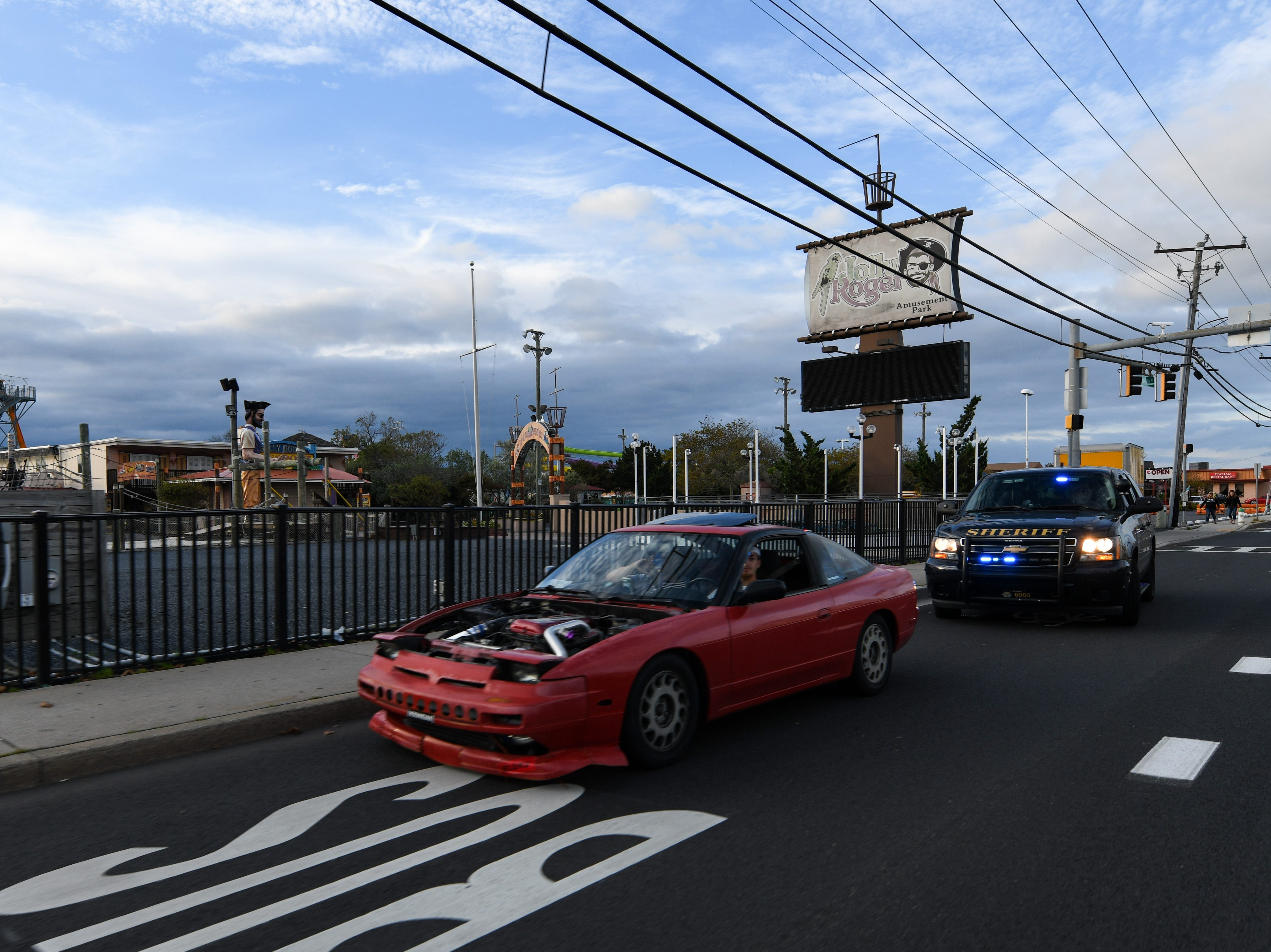 Ocean City police pull over a car driving with out a hood on Friday, Sept 28, 2018. Popular car show H2Oi  was traditionally held nearby and though it has now moved to Atlantic City attendees continue to flock to Ocean City.