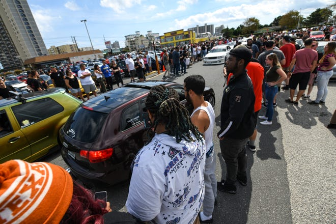 A crowd of hundreds gathers in the ACME parking lot on Saturday, Sept 29, 2018. Streets in the area were full of crowds and cars for the unofficial H2Oi weekend, despite the fact that the car show has moved to Atlantic City.