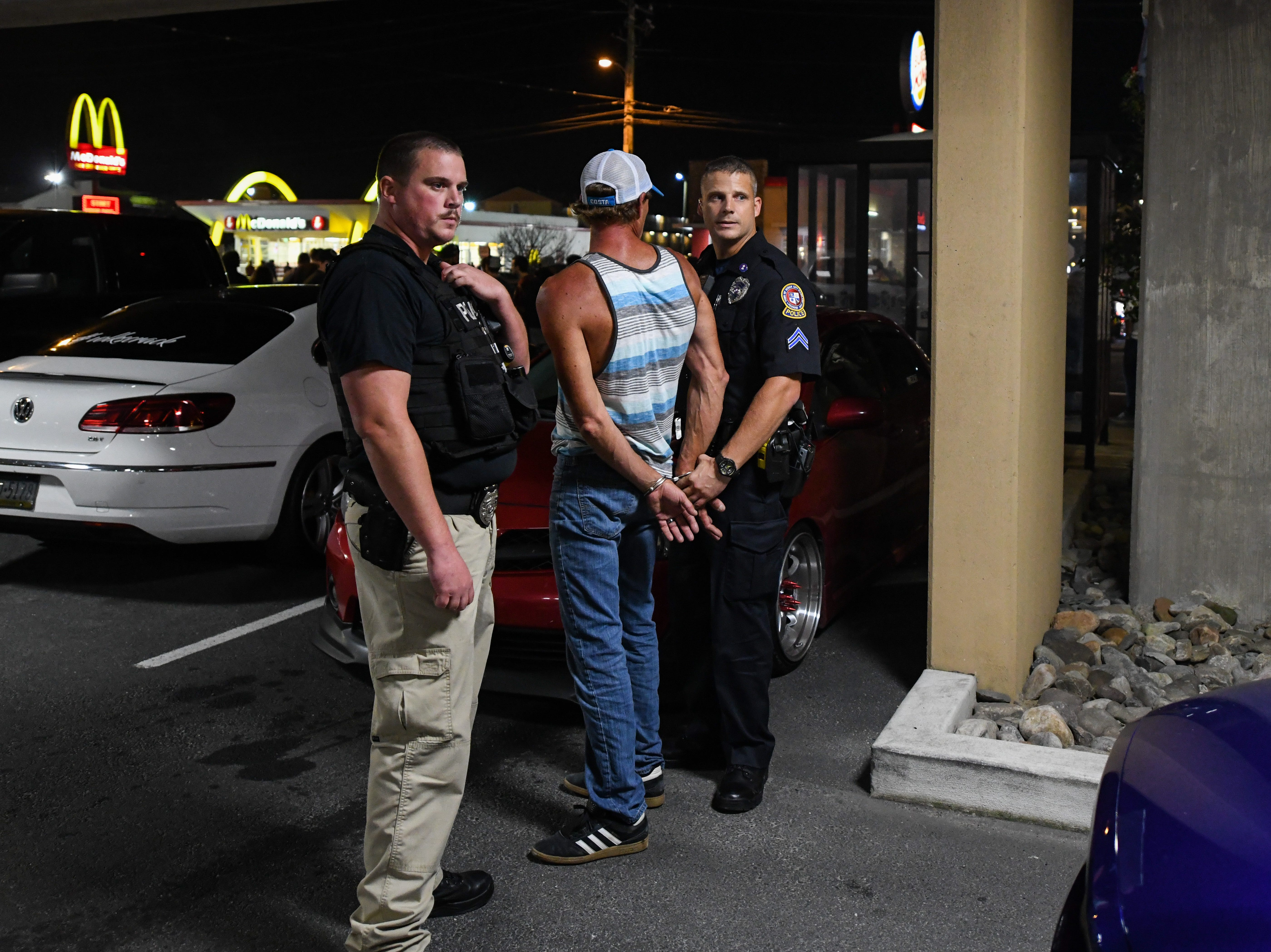 Corporal Jeff Johns arrests a man for disorderly conduct on Friday, Sept 28, 2018. Popular car show H2Oi  was traditionally held nearby and though it has now moved to Atlantic City attendees continue to flock to Ocean City.