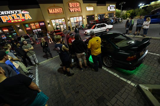 A crowd gathers around a driver who has just received a ticket for a traffic violation on Friday, Sept 28, 2018. Popular car show H2Oi  was traditionally held nearby and though it has now moved to Atlantic City attendees continue to flock to Ocean City.