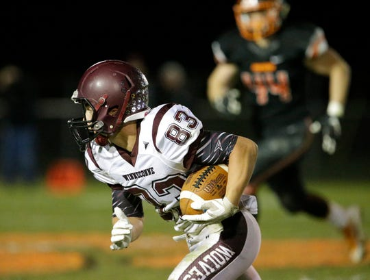 Winneconne's Jacob Omitt carries the ball against Plymouth on Friday.