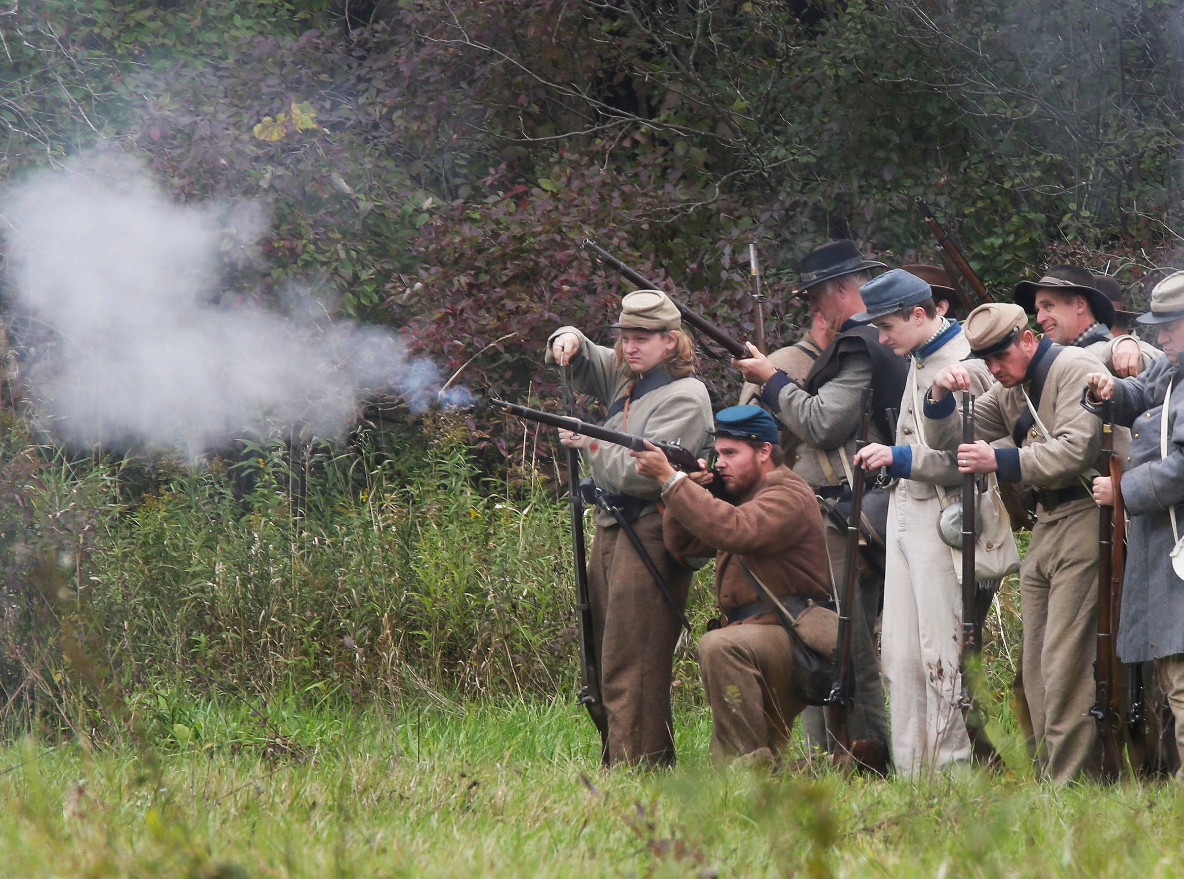 Confederate soldier fire their weapons during battle at the Civil War Weekend at the Wade House, Saturday September 29, 2018, in Greenbush, Wis.