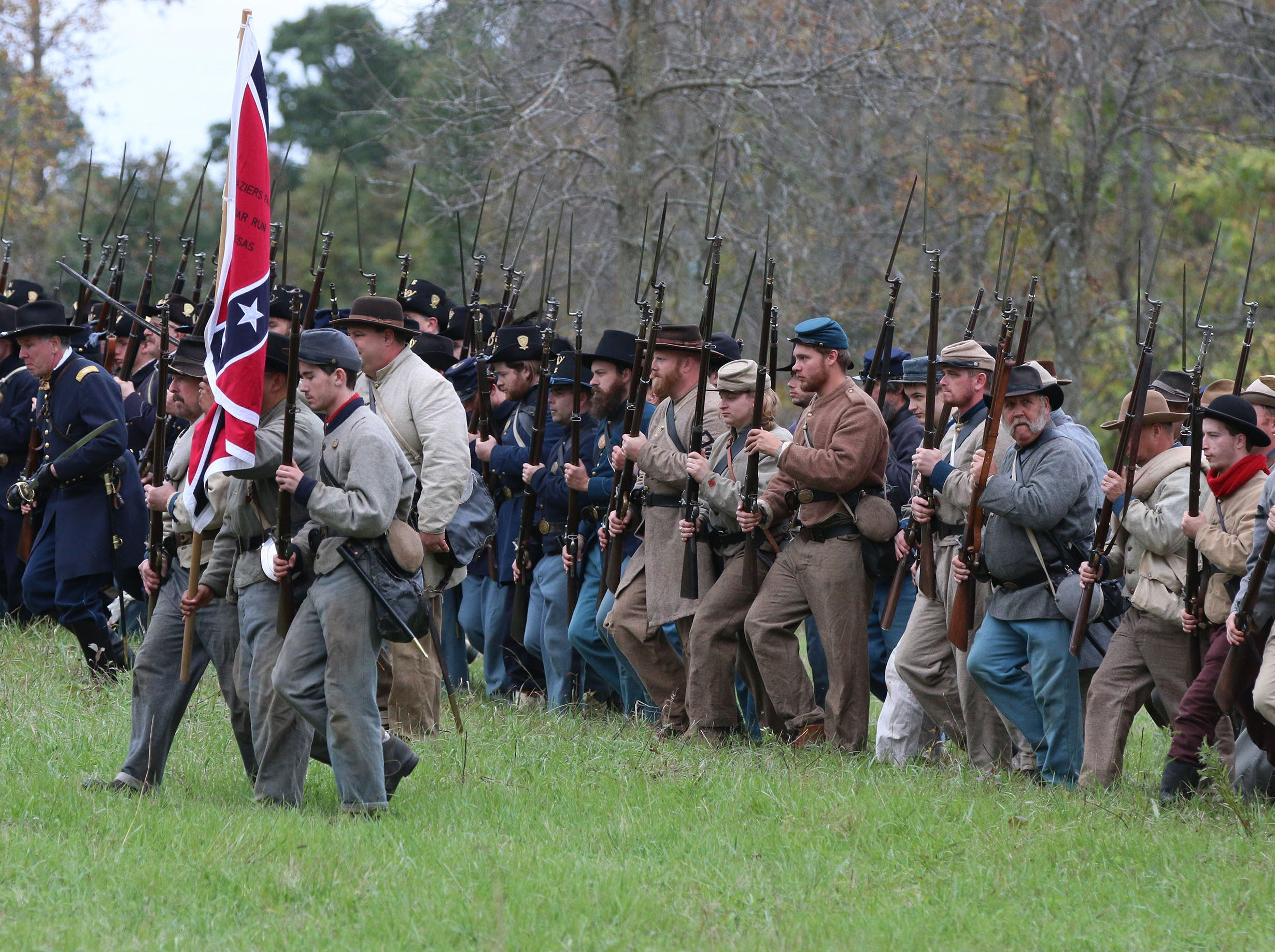 Civil War soldiers from both sides march following battle during the Civil War Weekend at the Wade House, Saturday September 29, 2018, in Greenbush, Wis.