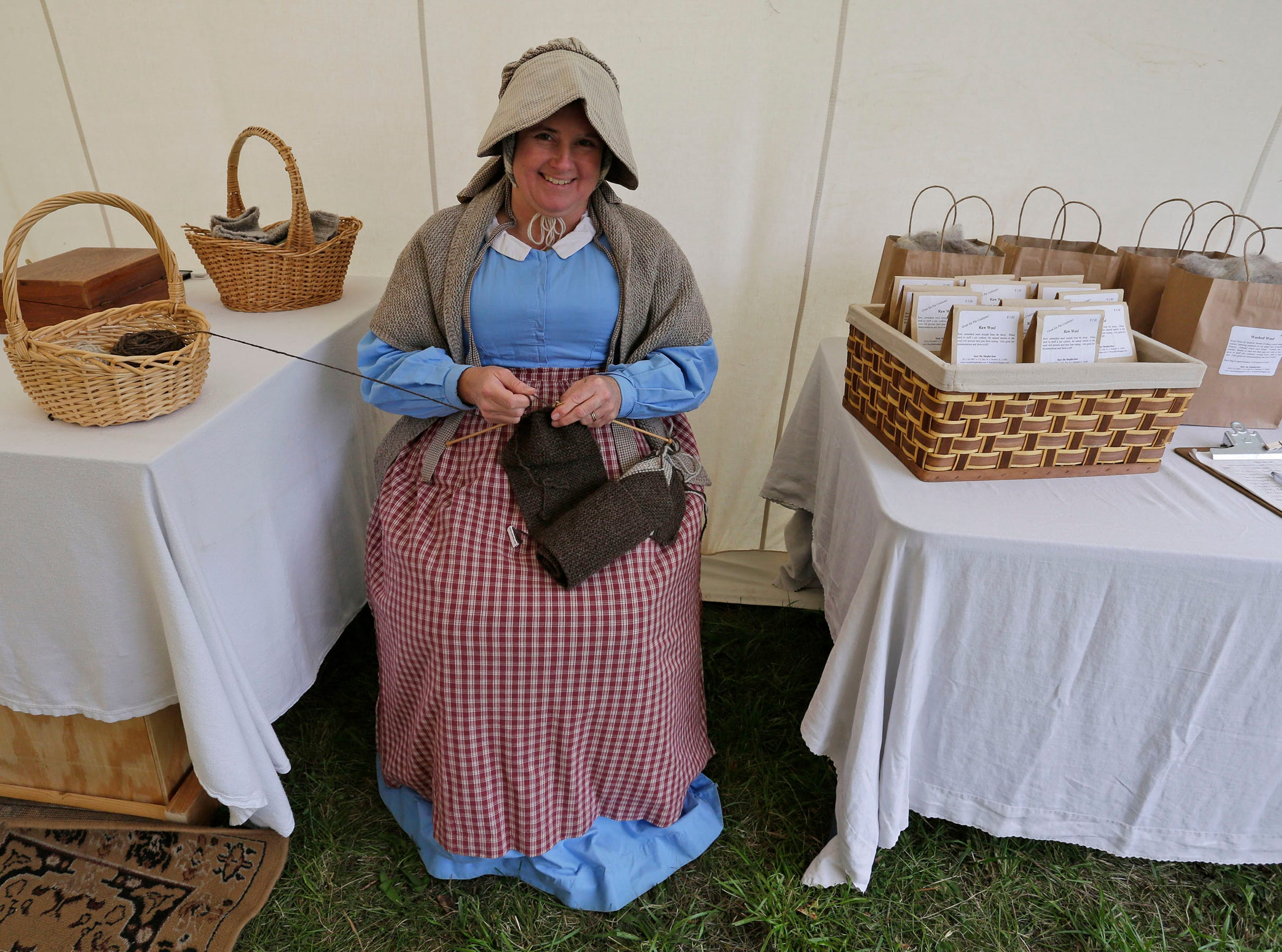 Suzy Beggin takes a break from knitting 19th century style items during the Civil War Weekend at the Wade House, Saturday September 29, 2018, in Greenbush, Wis.