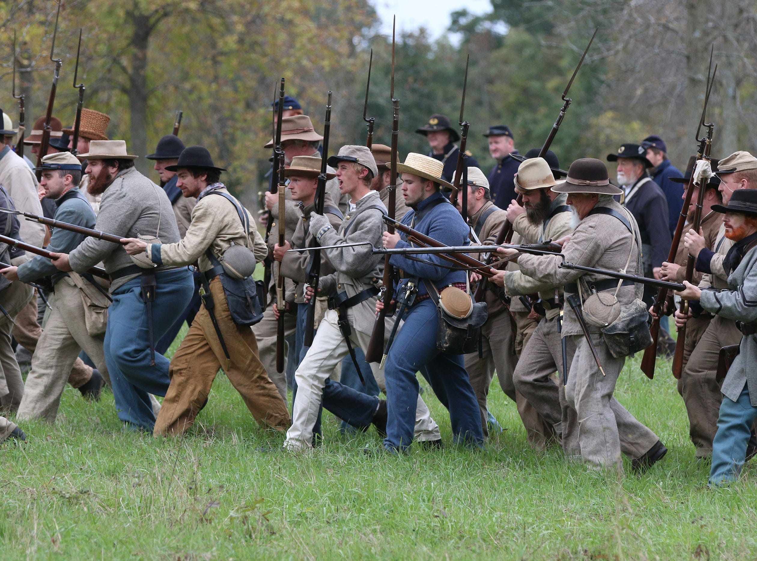 Confederate soldiers charge during the Civil War Weekend at the Wade House, Saturday September 29, 2018, in Greenbush, Wis.