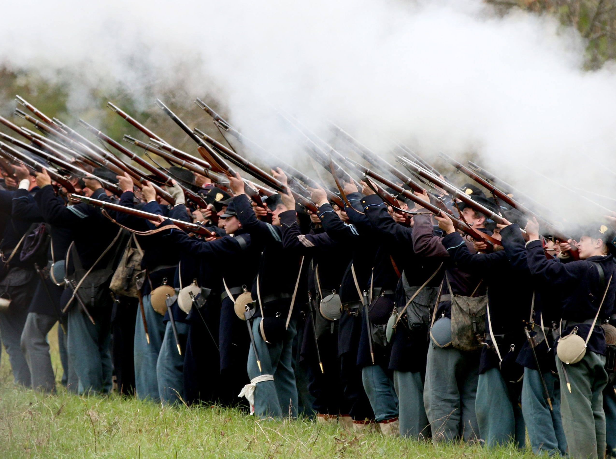 Union soldiers fire their weapons during the Civil War Weekend at the Wade House, Saturday September 29, 2018, in Greenbush, Wis.