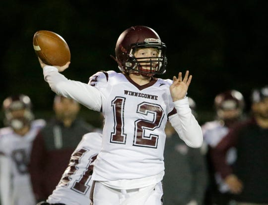 Winneconne's Harrison Roubidoux (12) passes the ball against Plymouth, Friday, September 28, 2018, in Plymouth, Wis.