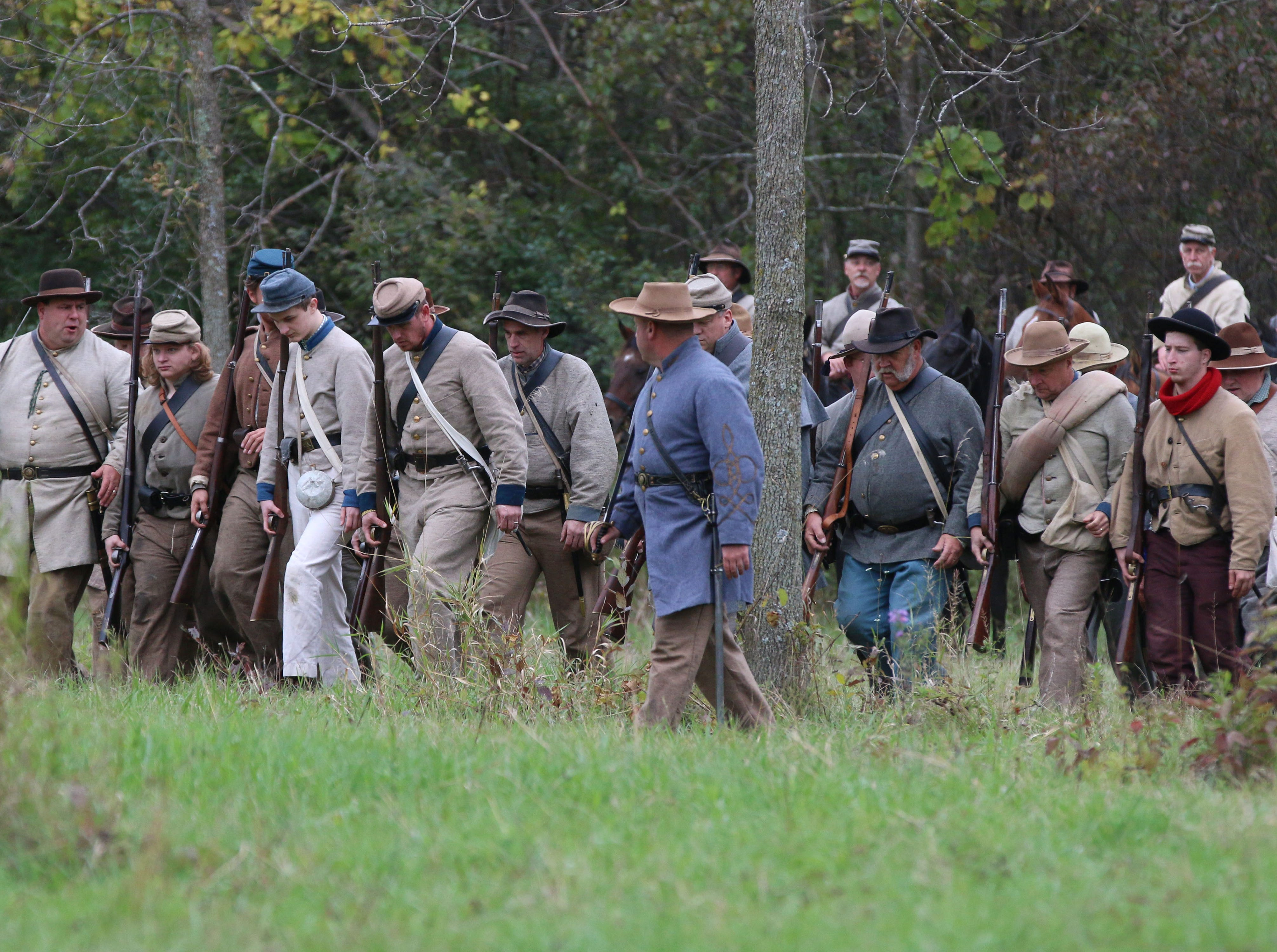 Confederate soldiers line up following battle during the Civil War Weekend at the Wade House, Saturday September 29, 2018, in Greenbush, Wis.