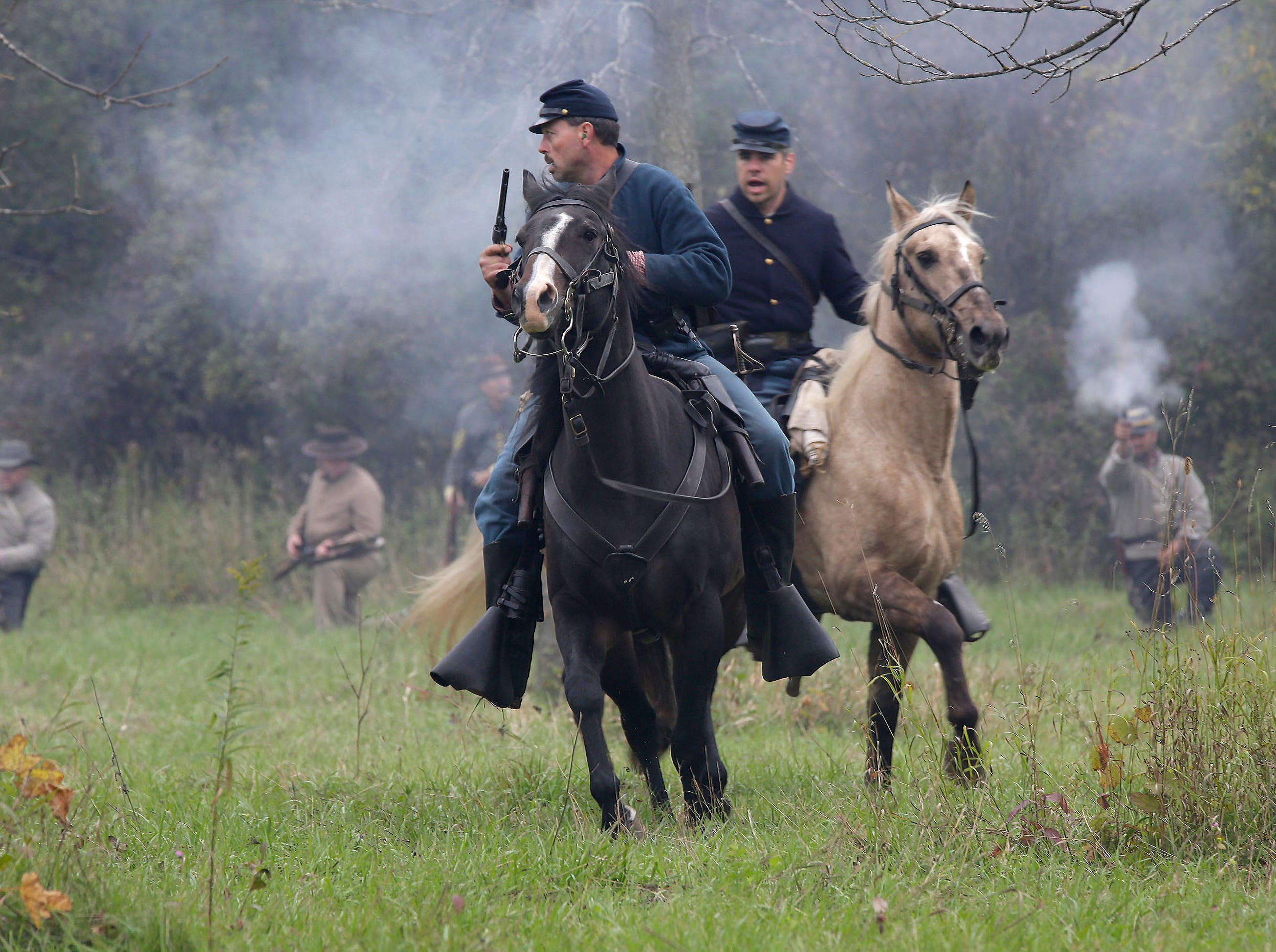 Union Calvary soldiers rides their horses during the Civil War Weekend at the Wade House, Saturday September 29, 2018, in Greenbush, Wis.
