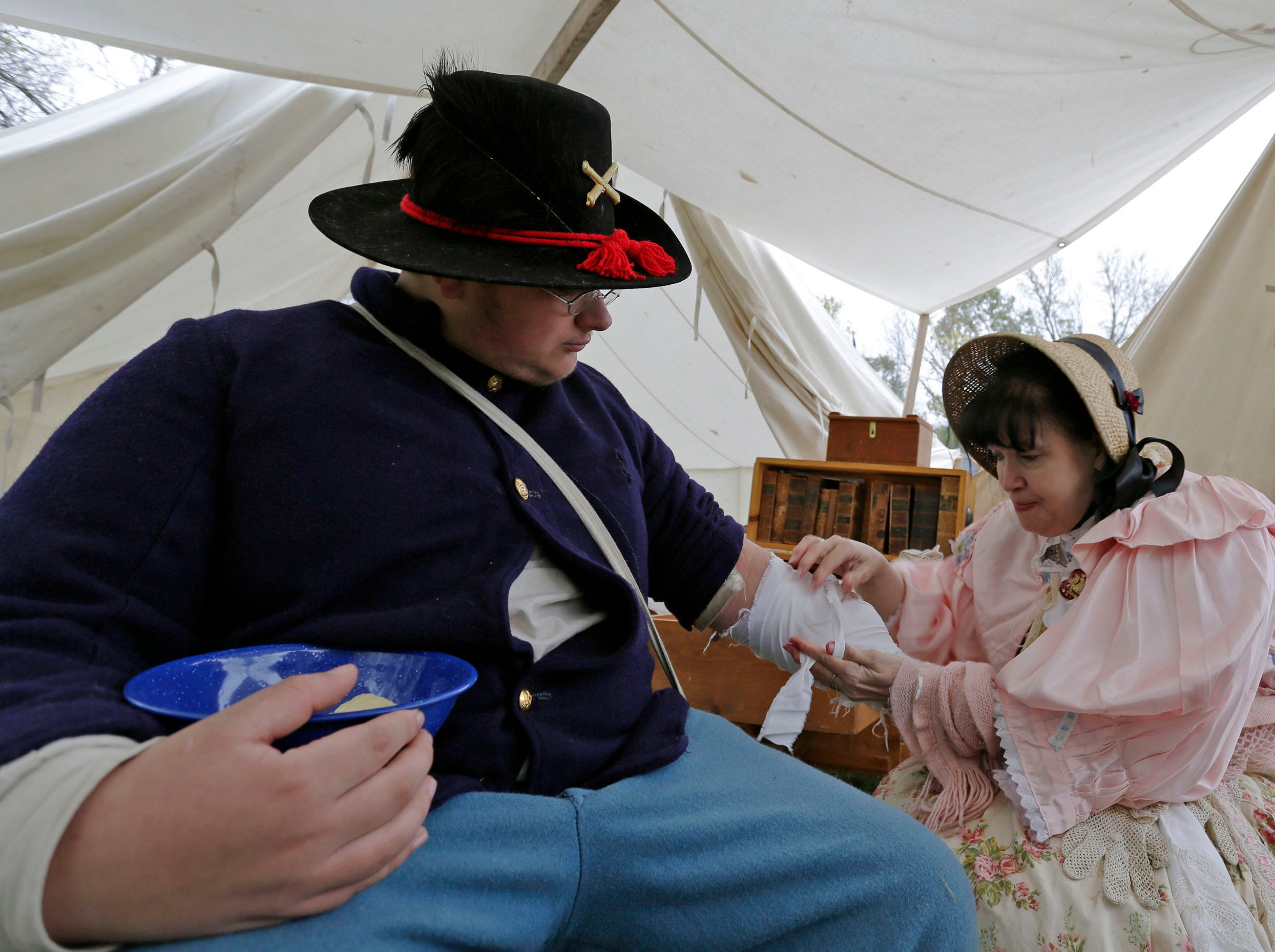 Reenactor Landon Zeichert of Tomah gets patched up by an actress portraying Dr. Rebecca Chisholm during the Civil War Weekend at the Wade House, Saturday September 29, 2018, in Greenbush, Wis.