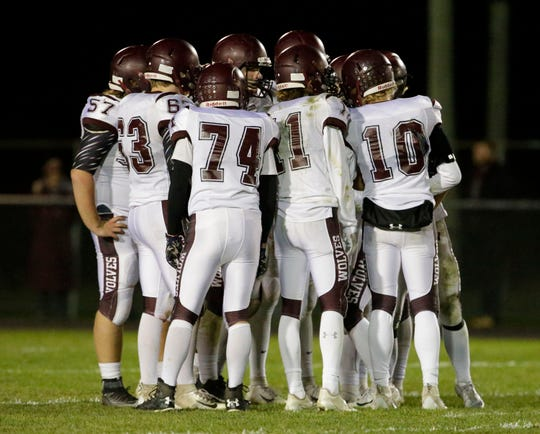 Winneconne players huddle during action with Plymouth, Friday, September 28, 2018, in Plymouth, Wis.