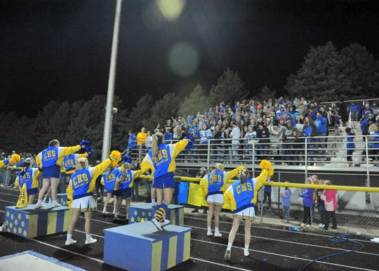 The Canton cheerleaders lead the student section in a cheer against Bridgewater-Emery/Ethan on Friday, Sept. 28, 2018, in Canton.