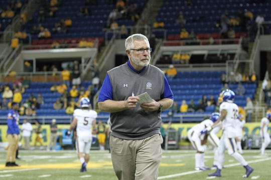South Dakota State Head Coach John Stiegelmeier makes some last minute preparations before SDSU's matchup against North Dakota State Saturday afternoon at the Fargodome in Fargo.