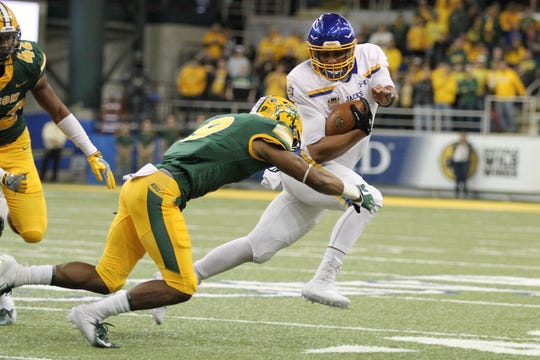 South Dakota State's Taryn Christion (3) tries to sprint past North Dakota State's Marquise Bridges during the first quarter of the Jackrabbits' matchup against the Bison Saturday afternoon at the Fargodome in Fargo.