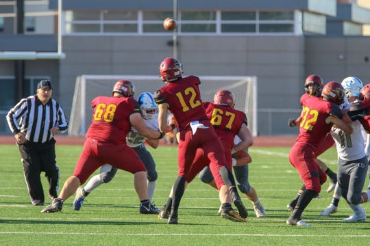 Roosevelts QB #12 Brady Dannenbring throws the ball accross the middle against O'Gorman Friday night at Howard Wood Field.