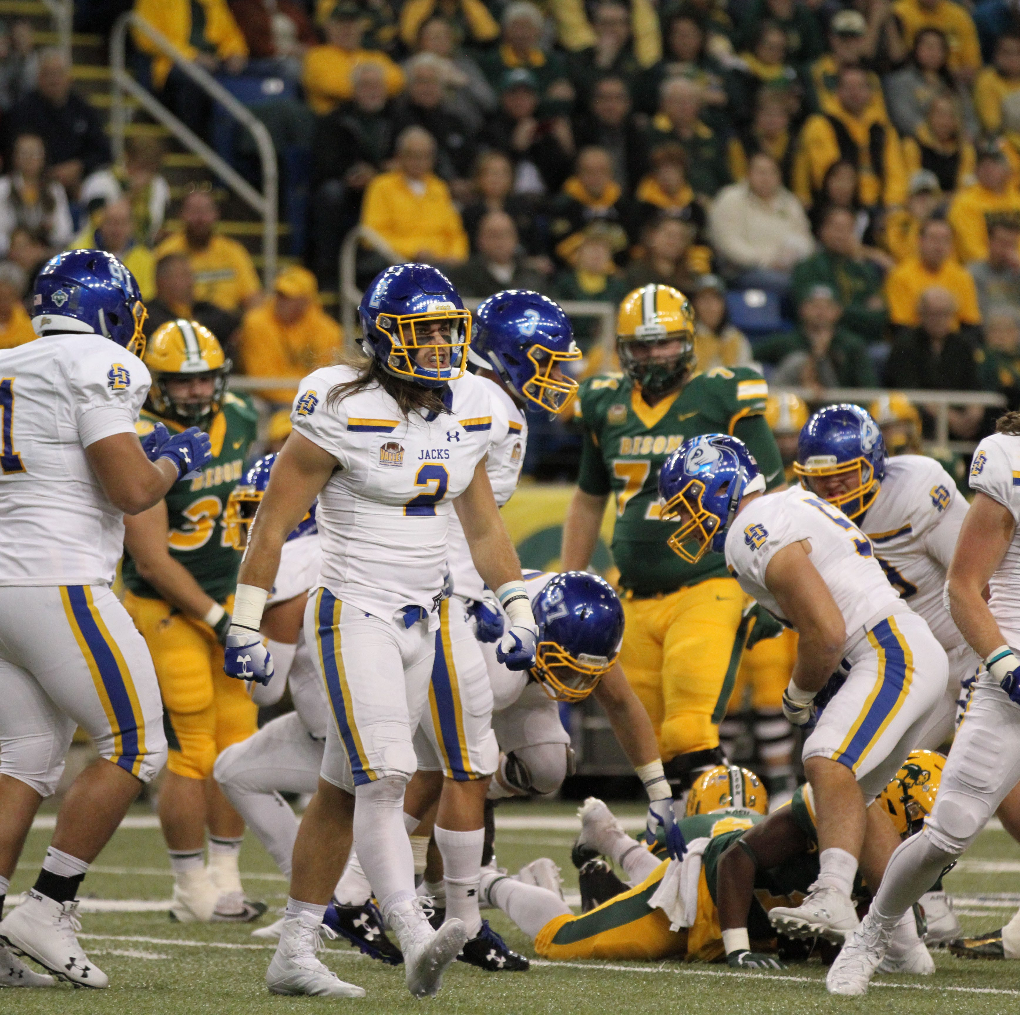 South Dakota State's Christian Rozeboom (2) and Eric Kleinschmit (31) celebrate a defensive stop during the first quarter of the Jackrabbits' matchup against North Dakota State Saturday afternoon at the Fargodome in Fargo.