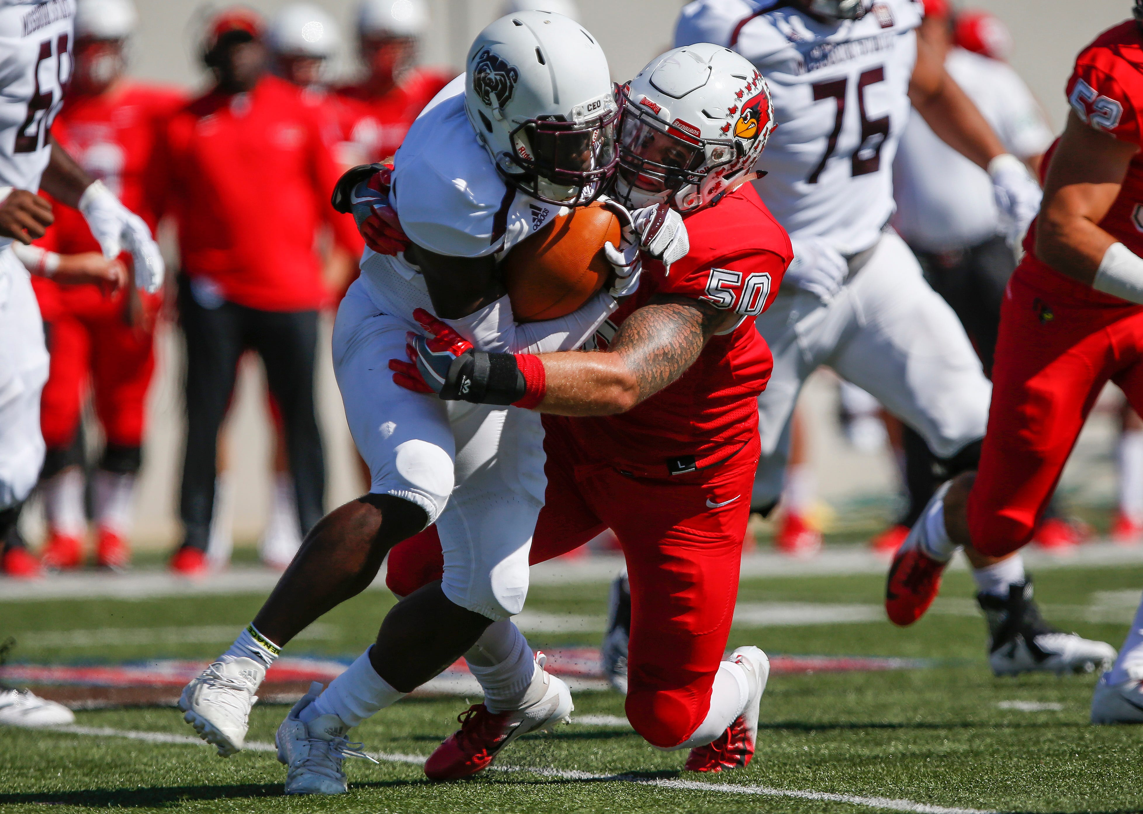 Jason Randall is brought down by Ty DeForest during the Missouri State Bears' game against the Illinois State Redbirds at Plaster Stadium on Saturday, Sept. 29, 2018.