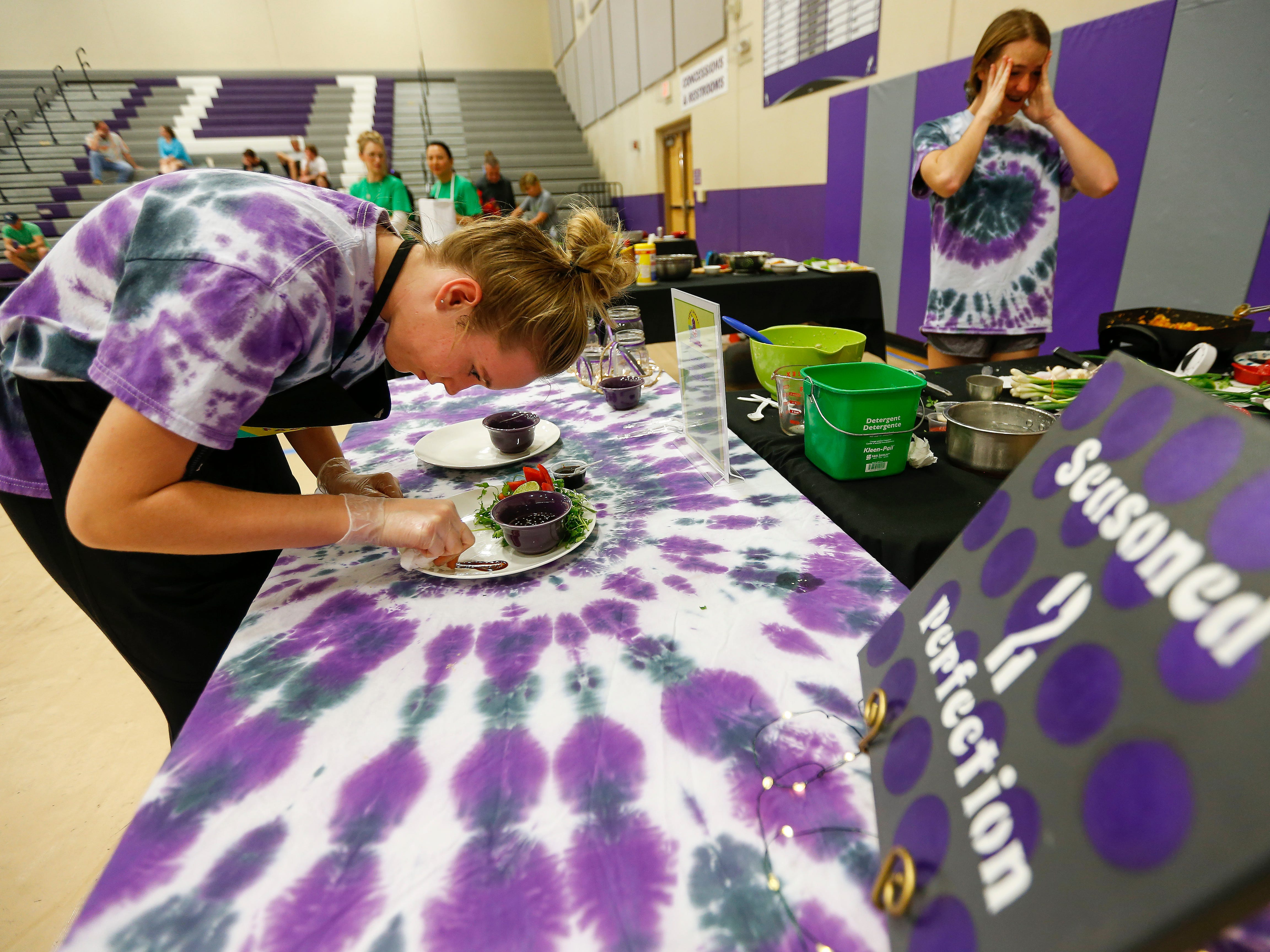 Students prepare their unique takes on Asian fusion dishes during the third annual Junior Chef Competition at Hickory Hills Middle School on Saturday, Sept. 29, 2018.