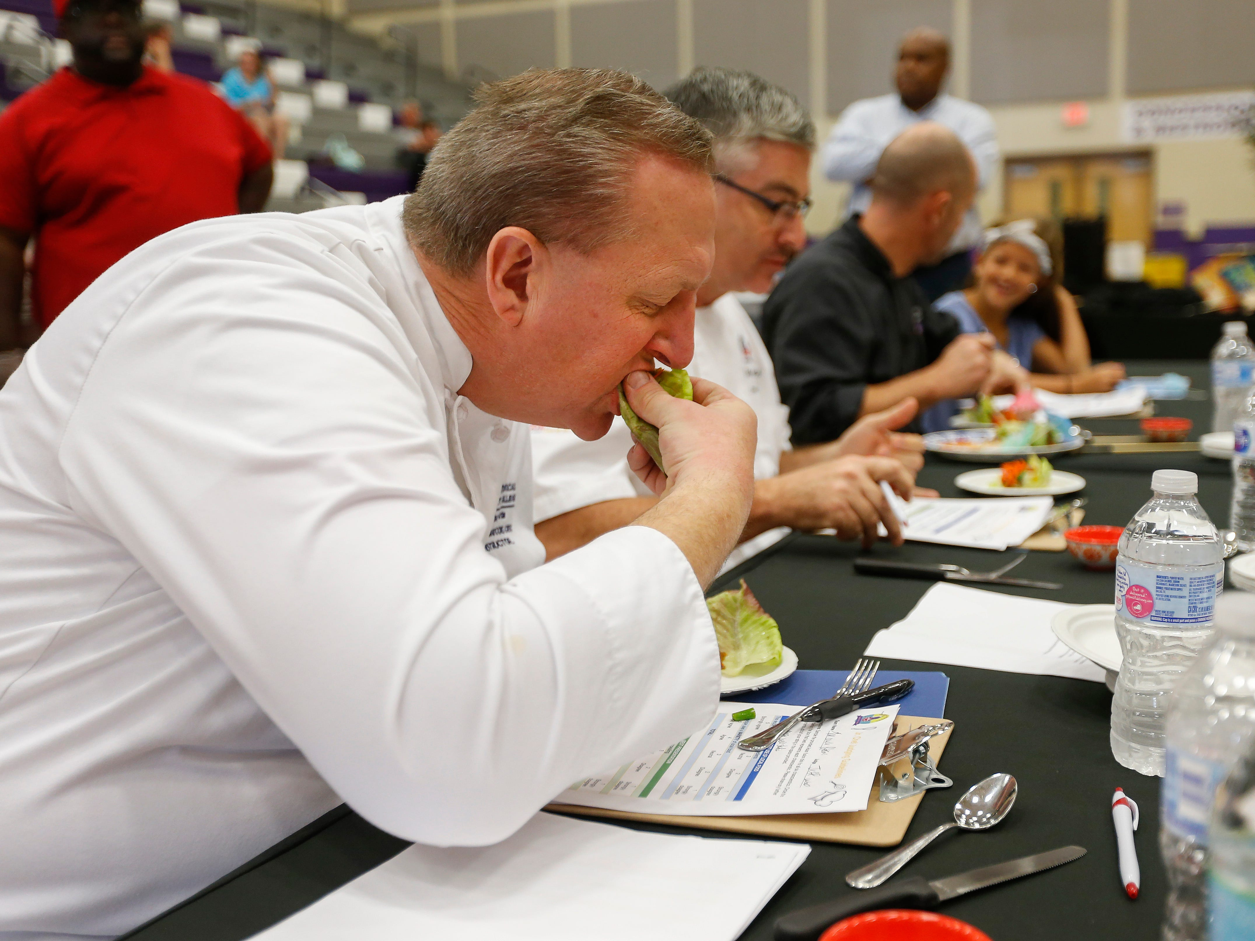 Chef Jeff Ward and the other judges taste a lettuce wrap during the third annual Junior Chef Competition at Hickory Hills Middle School on Saturday, Sept. 29, 2018.