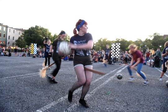 Slytherin meets Ravenclaw in Quidditch on the opening night of Queen City Mischief & Magic in downtown Staunton, Va., Sept. 28, 2018.